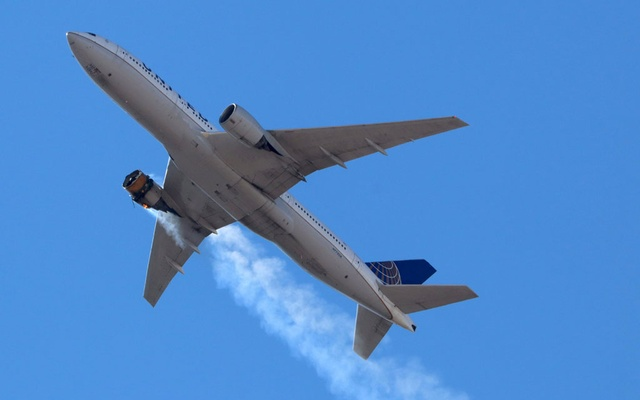 United Airlines flight UA328, carrying 231 passengers and 10 crew on board, returns to Denver International Airport with its starboard engine on fire after it called a Mayday alert, over Denver, Colorado, US February 20, 2021. REUTERS