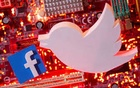 FILE PHOTO: 3D printed Facebook and Twitter logos are placed on a computer motherboard in this illustration taken January 21, 2021. REUTERS/Dado Ruvic/Illustration