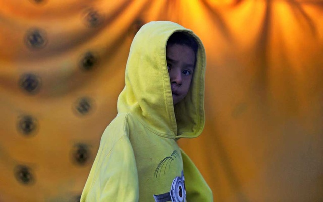 A migrant child who is seeking asylum in the US is pictured at a migrant encampment in Matamoros, Mexico February 19, 2021. REUTERS