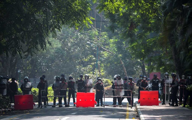 Riot police officers stand guard during a rally against the military coup at the University of Yangon. Reuters