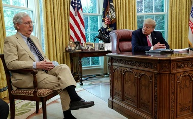 US President Donald Trump listens to Senate Majority Leader Mitch McConnell speak about legislation for additional coronavirus aid in the Oval Office at the White House in Washington, US, July 20, 2020. REUTERS
