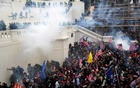 Police release tear gas into a crowd of pro-Trump protesters during clashes at a rally to contest the certification of the 2020 US presidential election results by the US Congress, at the US Capitol Building in Washington, US, January 6, 2021. REUTERS