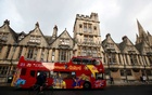A sightseeing bus passes Oxford University building, amid the spread of the coronavirus disease (COVID-19), in Oxford, Britain, October 6, 2020. Reuters