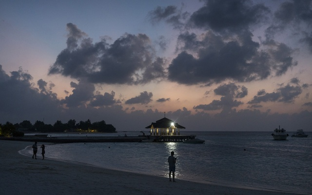 A beach on the island of Kandooma in the Maldives, Feb 12, 2017. By urging travelers to visit, the Maldives is reviving its luxury resorts. It's also risking new outbreaks and courting controversy on social media. (Adam Dean/The New York Times)