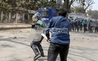 A Jatiyatabadi Chhatra Dal activist attacks policemen after the law enforcers foil their protest outside the National Press Club in Dhaka on Sunday, Feb 28, 2021 before the demonstration began to demand justice for writer Mushtaq Ahmed who died in jail and the cancellation of the Digital Security Act which was used to arrest him.