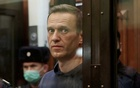 A still image taken from video footage shows Russian opposition leader Alexei Navalny, who is accused of flouting the terms of a suspended sentence for embezzlement, inside a defendant dock during the announcement of a court verdict in Moscow, Russia February 2, 2021.