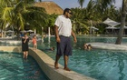 A security guard in the pool area at Holiday Inn Resort Kandooma Maldives, Feb 12, 2017. Tourism employs more than 60,000 people in the country, more than any other industry in the private sector. (Adam Dean/The New York Times)