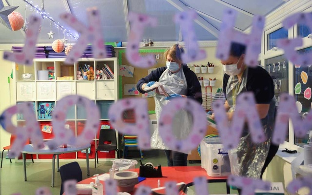 Nursery staff members at Little Stars Childcare take part in the Staffordshire County Council's pilot testing initiative to allow nurseries to test staff weekly, amidst the spread of the coronavirus disease (COVID-19), in Newcastle-under-Lyme, Staffordshire, Britain February 15, 2021. REUTERS