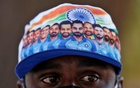 A fan wearing a cap featuring Indian cricket players waits to enter the newly named Narendra Modi Stadium, previously known as Motera Stadium, before the start of the third Test match between India and England, in Ahmedabad, India, February 24, 2021. REUTERS