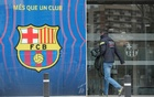 A Mosso d'Esquadra police officer enters the offices of FC Barcelona in Barcelona, Spain, March 1, 2021. REUTERS