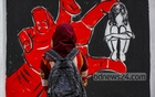 A student looks at a graffiti on rape of women drawn on the walls of the Dhaka University campus. Photo: Mahmud Zaman Ovi