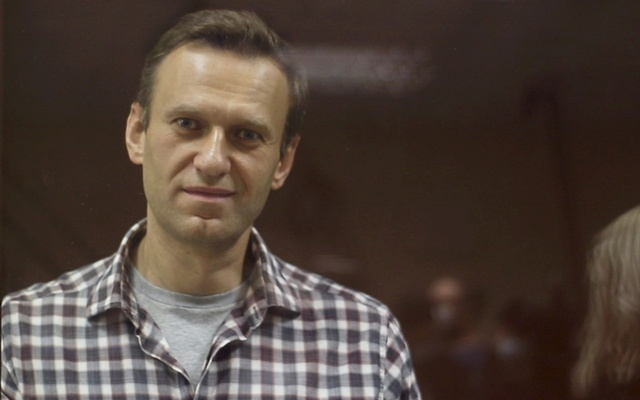 Kremlin critic Alexei Navalny, who is accused of slandering a Russian World War Two veteran, stands inside a defendant dock during a court hearing in Moscow, Russia, Russia February 20, 2021, in this still image taken from video. Press Service of Babushkinsky District Court of Moscow via REUTERS