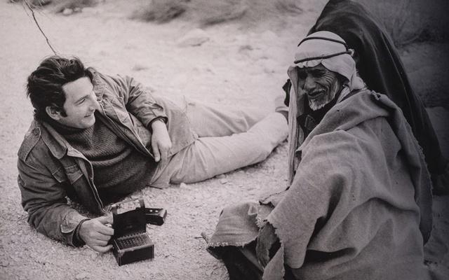 An archival photo provided by Boris Carmi, via Clinton Bailey shows Bailey, left, an Israeli researcher, with a Bedouin man in the Negev Desert, Southern Israel. After 50 years of fieldwork in the Negev and Sinai deserts, Bailey donated his rare archive to the National Library of Israel. (Boris Carmi, via Clinton Bailey via The New York Times)