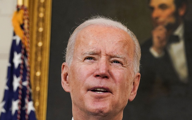 Standing in front of a portrait of former President Abraham Lincoln, US President Joe Biden speaks about the Biden administration's coronavirus disease (COVID-19) pandemic response in the State Dining Room at the White House in Washington, US, March 2, 2021. REUTERS