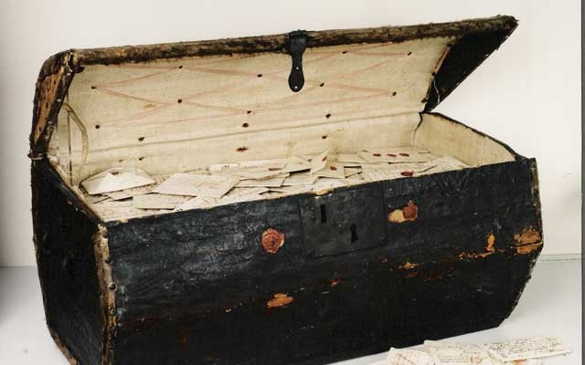 In an undated handout image, a 17th-century trunk that belonged to the postmasters Simon and Marie de Brienne, which were scanned by X-ray microtomography. Unlocking History Research Group via The New York Times