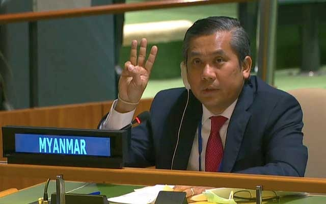 """An image from video provided by the United Nations shows Myanmar's ambassador to the UN, Kyaw Moe Tun, flashing the three-finger salute, a symbol of anti-junta resistance borrowed from """"The Hunger Games"""" films, at the end of a speech pleading for international action in overturning the military coup in the country, in New York, Feb 26, 2021. United Nations via The New York Times"""