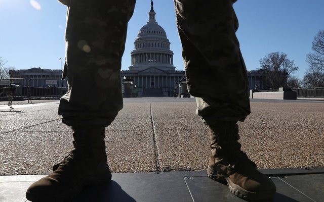 A member of the US National Guard stands watch in front of the US Capitol Building amid heightened security following the assault on the building on January 6 in Washington, US, March 3, 2021. REUTERS/Leah Millis