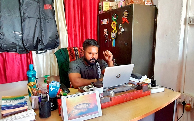 Denis Giles, editor of Indian newspaper Andaman Chronicle, works inside his office in Port Blair, the capital of Andaman and Nicobar archipelago, India, March 1, 2021. REUTERS