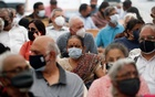 People wait to receive a dose of COVISHIELD, a COVID-19 vaccine manufactured by Serum Institute of India, in Mumbai, India, Mar 1, 2021. REUTERS