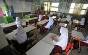 Students attend a learning session at a school in Padang, West Sumatra province, Indonesia, in this photo taken January 4, 2021 by Antara Foto. Antara Foto/Iggoy el Fitra/ via REUTERS