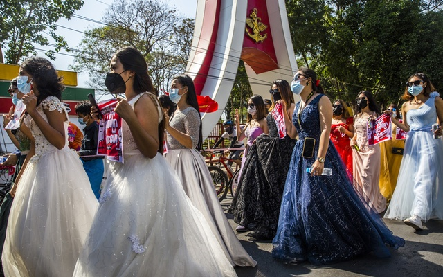 A group of women wearing formal gowns march in Yangon, Myanmar, on Feb 10, 2021, to protest against the military coup. The New York Times