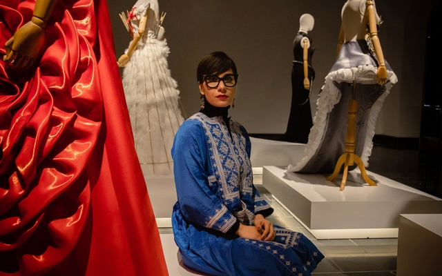 FILE -- Rada Akbar, a Kabul-based photojournalist and artist, at her annual art exhibition, in Kabul, Afghanistan, March 13, 2020, called