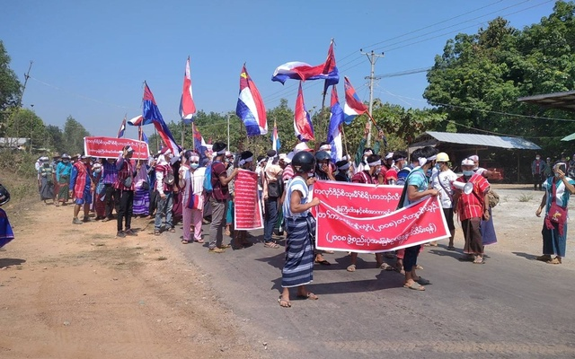 Protesters hold placards during the ant-coup protest in Hpapun Township, Kayin State, Myanmar Mar 5, 2021. REUTERS