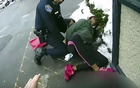 A photo provided by the Rochester New York Police Department, a Rochester police officer attempts to subdue a woman suspected of shoplifting with her 3-year-old daughter in Rochester, NY, Mar 5, 2021. The officer tackled and used pepper spray on a woman who had been accused of shoplifting and was with her young daughter last month, according to police body-camera videos of the episode that were released on Friday. The New York Times