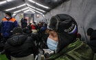 People gather in the Rescue Shelter, which was opened by the Orthodox charity organisation Miloserdie to provide services to the homeless, in Moscow, Russia February 16, 2021. Reuters