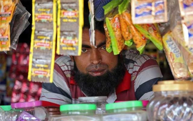 A man from the Rohingya community looks on as he sits inside his shop at a camp on the outskirts of Jammu October 5, 2018. Picture taken October 5, 2018. REUTERS