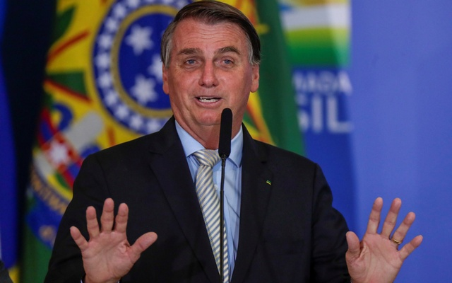 Brazil's President Jair Bolsonaro gestures during a ceremony at the Planalto Palace in Brasilia, Brazil February 24, 2021. REUTERS