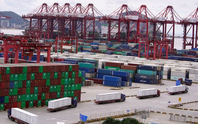Containers and lorries are seen at the Yangshan Deep Water Port in Shanghai, China, as the coronavirus disease (COVID-19) outbreak continues, October 19, 2020. Reuters