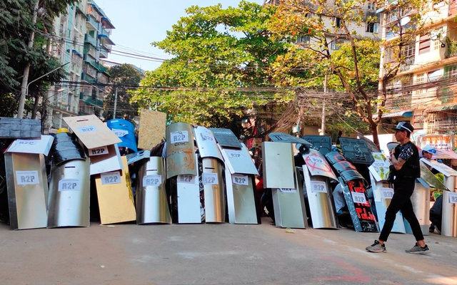 Protesters set up a makeshift shield formation in preparation for potential clashes, in Yangon, Myanmar March 6, 2021, in this still image from a video obtained by Reuters.