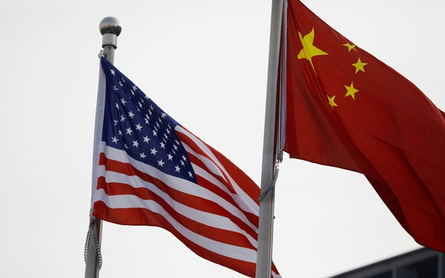 Chinese and US flags flutter outside the building of an American company in Beijing, China January 21, 2021. REUTERS