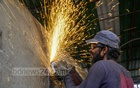 A worker welding metal at Shmashana Ghat in Dhaka's Postogola has only glasses for protection from the dangers. Photo: Mahmud Zaman Ovi