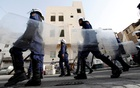 Riot police patrol the streets near the British embassy prior to an anti-government protest in support of Bahraini human rights activist Abdulhadi al-Khawaja in Manama Apr 14, 2012. REUTERS