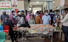 Three evacuated COVID-19 patients have died after a fire broke out in the ICU ward at Dhaka Medical College Hospital on Wednesday, Mar 17, 2021. Relatives gather around one of them. Photo: Asif Mahmud Ove