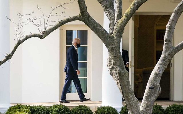 President Joe Biden walks back into the Oval Office at the White House in Washington, March 9, 2021. The New York Times