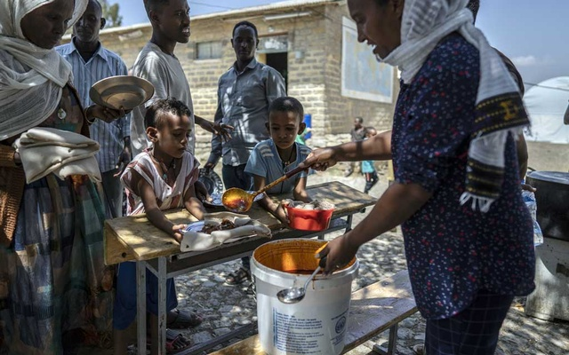 Refugees gather for lunch donated by the local population at a makeshift camp situated inside a secondary school for internally displaced people in Mekelle, capital of the Tigray region of Ethiopia, on March 1, 2020. The New York Times