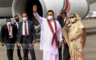 Mahinda Rajapaksa waving while getting off the Sri Lankan Air flight after he arrived in Dhaka. Prime Minister Sheikh Hasina received him at the airport. Photo: PMO