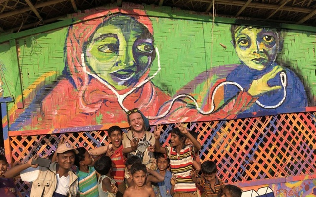 A photo provided by S M Suza Uddin, via Artolution, Max Frieder, centre, co-founder of Artolution, and Mohammed Armin, far left, a teaching artist, with Rohingya children at the Balukhali refugee camp in Bangladesh, March 2, 2019. (S M Suza Uddin, via Artolution via The New York Times)