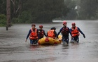 A State Emergency Service rescue team uses an inflatable raft to bring a local resident to safety from a flooded home as the state of New South Wales experiences widespread flooding and severe weather, in Sydney, Australia, March 21, 2021. REUTERS/Loren Elliott