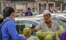 Price of green coconut water shoots up but people are still drinking it as the mercury rises. Photo: Mahmud Zaman Ovi