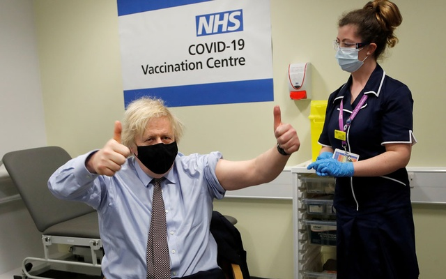 British Prime Minister Boris Johnson reacts after receiving a dose of the Oxford/AstraZeneca COVID-19 vaccine, amid the coronavirus disease pandemic, in London, Britain March 19, 2021. Frank Augstein/Pool via REUTERS