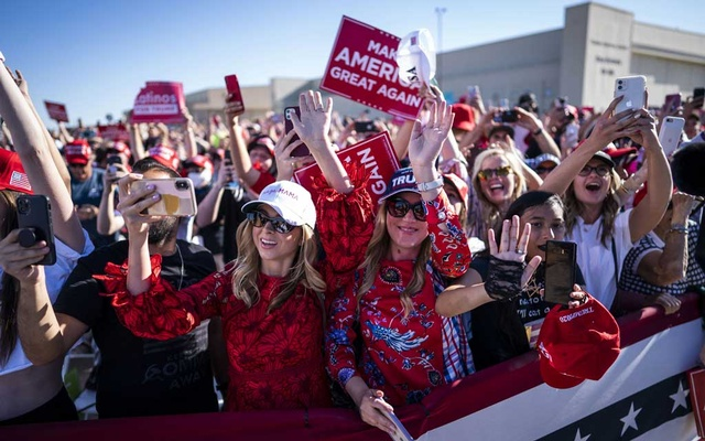 """Attendees cheer for then President Donald Trump during a campaign rally at the Phoenix Goodyear Airport in Goodyear, Ariz, Oct 28, 2020. """" The New York Times"""