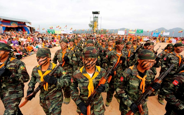 Soldiers from the Shan State Army-South march in formation during a military parade celebrating the 69th Shan State National Day at Loi Tai Leng, the group's headquarters, on the Thai-Myanmar border Feb 7, 2016. REUTERS