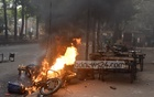 BNP activists torch a motorcycle during clashes with the police outside their Chattogram office at Nasimon Bhaban on Monday, Mar 29, 2021. Photo: Suman Babu
