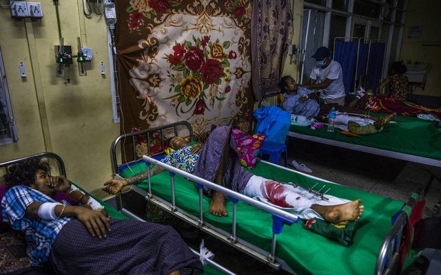 """A makeshift treatment ward for people with gunshot wounds in the Myanmar capital of Yangon, Mar 15, 2021. Four officers spoke about life in the feared Tatmadaw, which has turned its guns on civilians again. """"The Tatmadaw is the only world"""" for most soldiers, one said. The New York Times"""