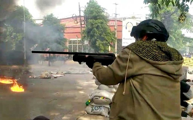 A protester fires a homemade air gun during a protest against the military coup, in Mandalay, Myanmar March 27, 2021 in this still image taken from video obtained by REUTERS. Video obtained by REUTERS