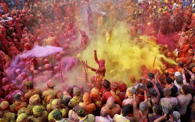 Men throw coloured powder at each other during Lathmar Holi celebrations in the town of Nandgaon, in the northern state of Uttar Pradesh, India, March 24. Reuters
